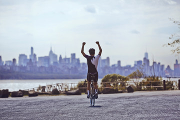 Cyclist cheering on bicycle
