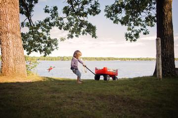 Boy playing by lake