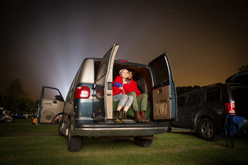 Couple sitting in car at night