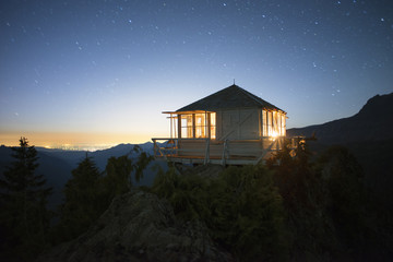 View of tree house against starry sky