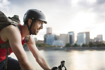 Side view of smiling cyclist