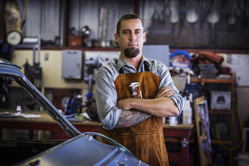 Portrait of mechanic at workshop
