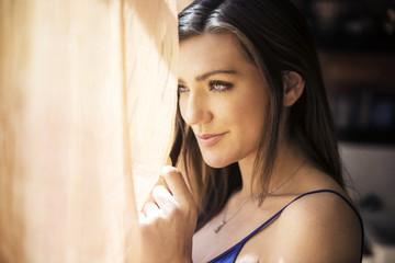 Woman looking trough window