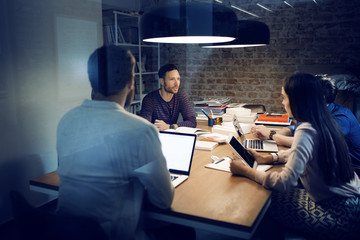 Four people talking in office
