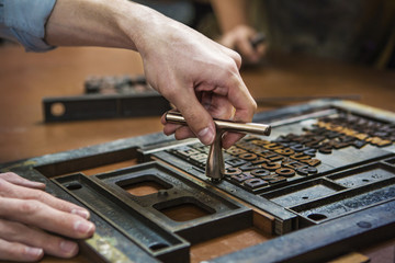 Close-up of man working with letterpress