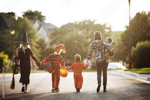 Rear view of a family dressed up in costume for Halloween
