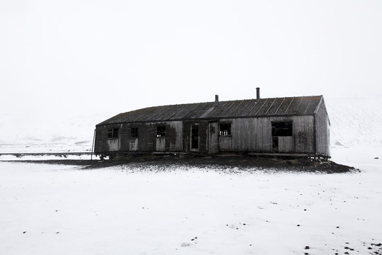 Old wooden barn with snowy landscape
