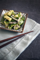 Vegetable salad served with chopsticks
