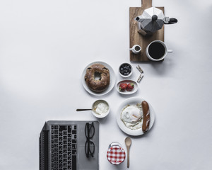 Overhead view of breakfast and laptop