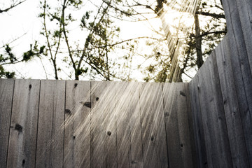 Outdoor shower with wooden fence