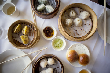 Overhead view of dumplings and buns on table in the restaurant