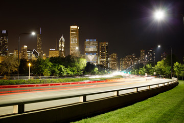 Light trails in front of Chicago skyline