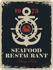 Retro banner for a seafood restaurant with a picture of an anchor, and the wheel and crab