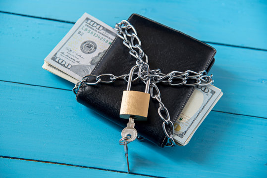 locked dollar money purse with metal chain link with padlock