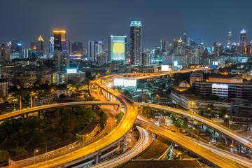 road at night in Bangkok city , Thailand.