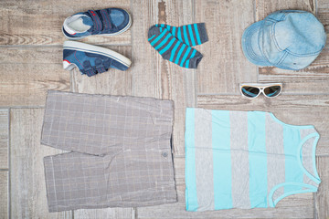 Flat lay photography of boy's casual outfit.