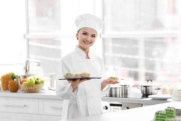 Female chef working at kitchen
