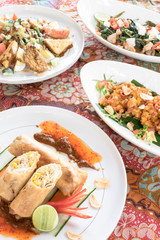 Indonesian traditional food plates on Batik cloth