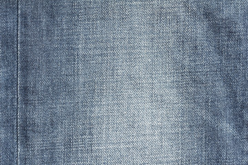 Closeup denim jeans texture. Stitched textured blue denim jeans background. Old grunge vintage denim jeans. Denim jeans of fashion design.