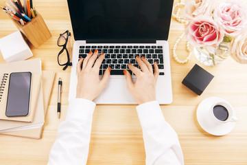 Female typing on keypad