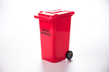 red garbage figure on white background