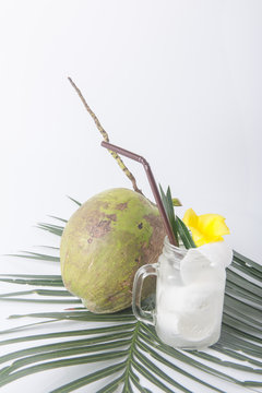 Fresh coconut drink with young coconut on white background