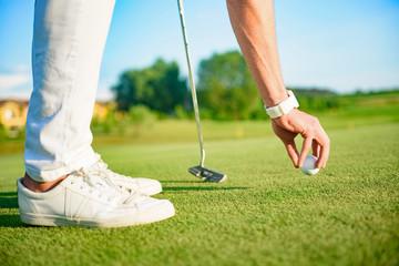 Golfer setting ball to strike