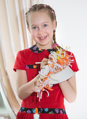 Little girl demonstrating her art craft works, Paper Lion mask she made. Educational and creative concept.