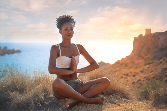 Beautiful woman doing yoga in an amazing natural place