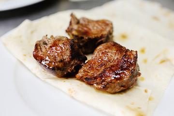 Appetizing shish kebab on pita bread