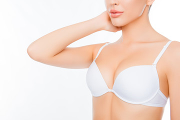 Closeup portrait of young sexy woman in white bra