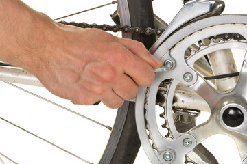 Man repairing chainring on a bicycle
