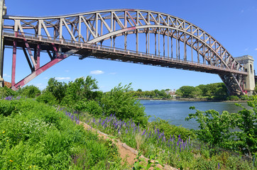 The Hell Gate Bridge (East River Arch Bridge) in New York City is a railroad only bridge, not used for passenger cars, and was a model for the Sydney Harbour Bridge in Australia
