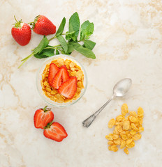 corn flakes and strawberries for Breakfast