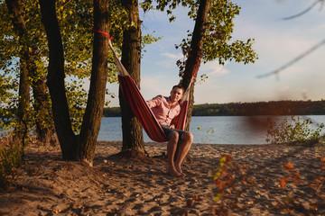 man laying in the hammock