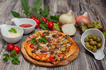 pizza  with mushrooms and pepperoni , tomatoes