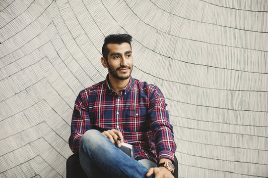 Portrait of young man wearing plaid shirt