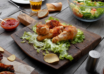 Grilled chicken legs with sauce