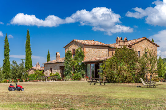 Brick house in the countryside of Tuscany, Italy. Rural landscape.