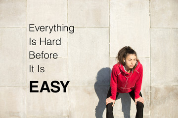 "Woman resting after running. Motivational phrase ""Everything is"