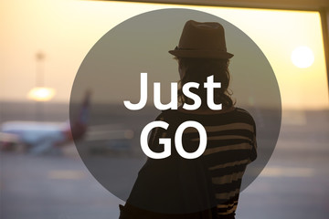 """Woman looking at planes. Motivational text """"Just go"""""""
