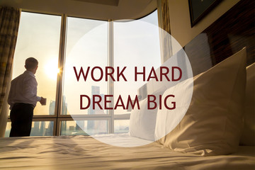 "Business man morning. Motivational text ""Work hard Dream big"""