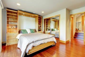 Bright bedroom with storage combination, sliding-door mirror war