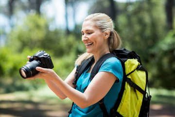 Woman smiling and looking her camera