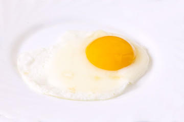 fried egg on the plate isolated