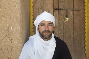 Bereber man next to the adobe wall. Ben Haddou, Morocco.