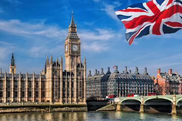 Fototapete - Big Ben with flag of United Kingdom in London, UK