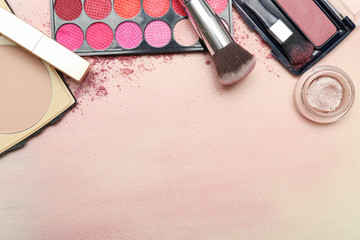 Set of various makeup products in pink tone