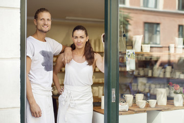 Woman and man standing at entrance to ceramics workshop