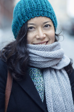 Portrait of smiling woman standing on city street